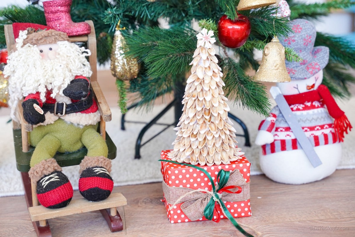 Pistachio shell Christmas tree craft with Santa and snowman decoration
