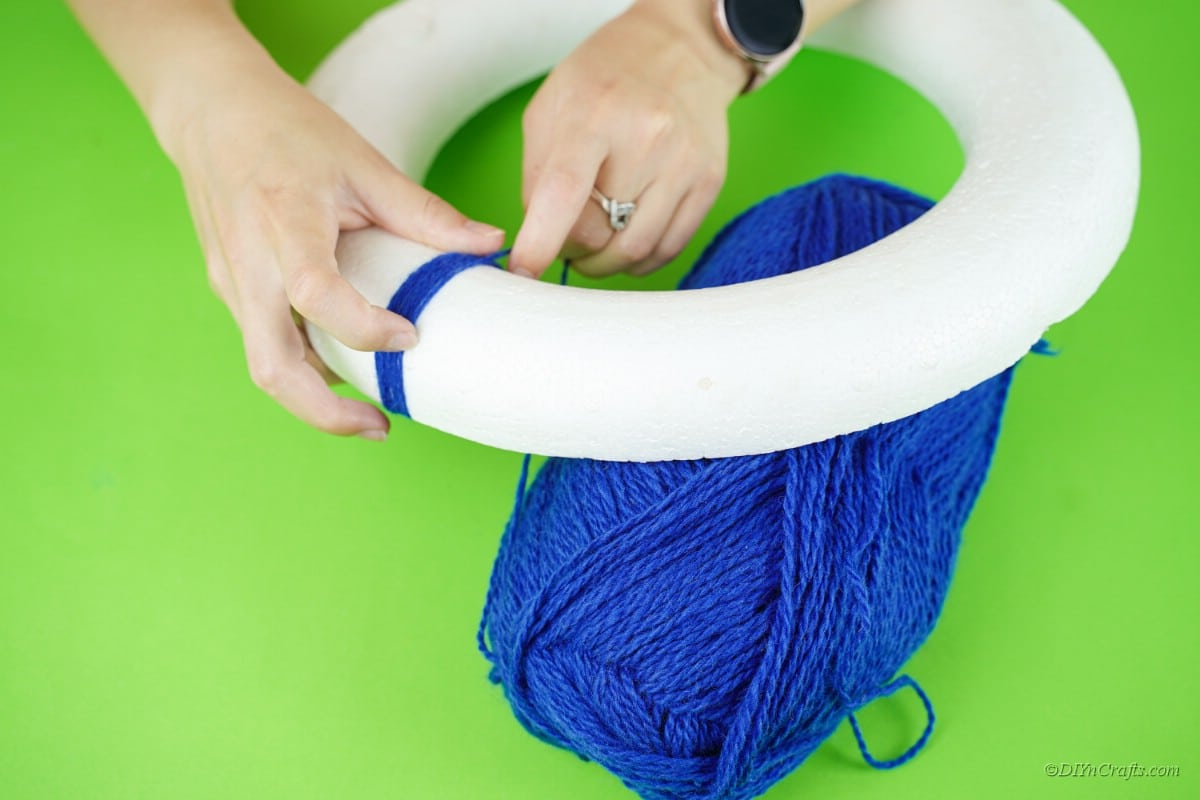 blue yard being affixed to a foam floral ring