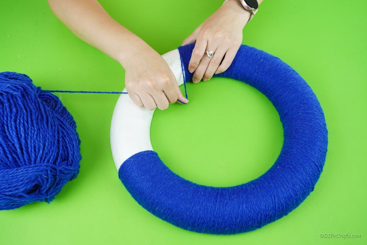 yarn wrapped around white foam ring