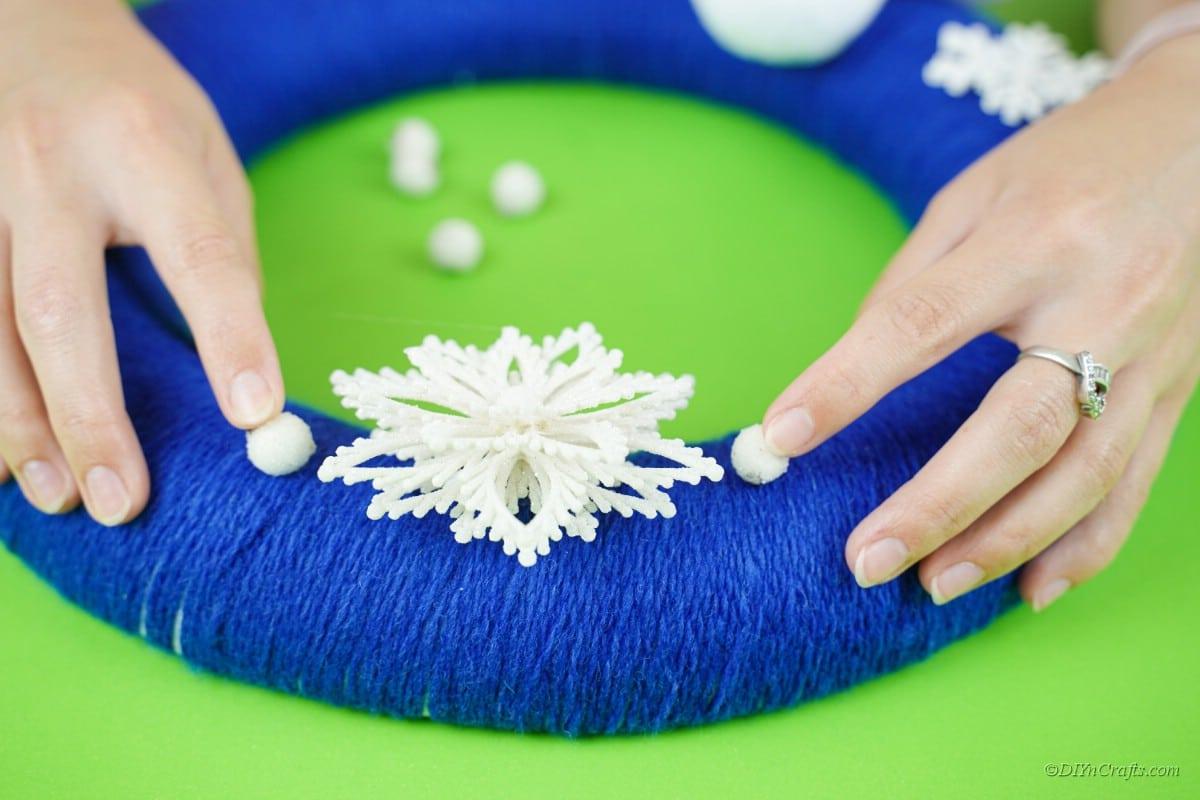 snowflake decorations on blue wreath