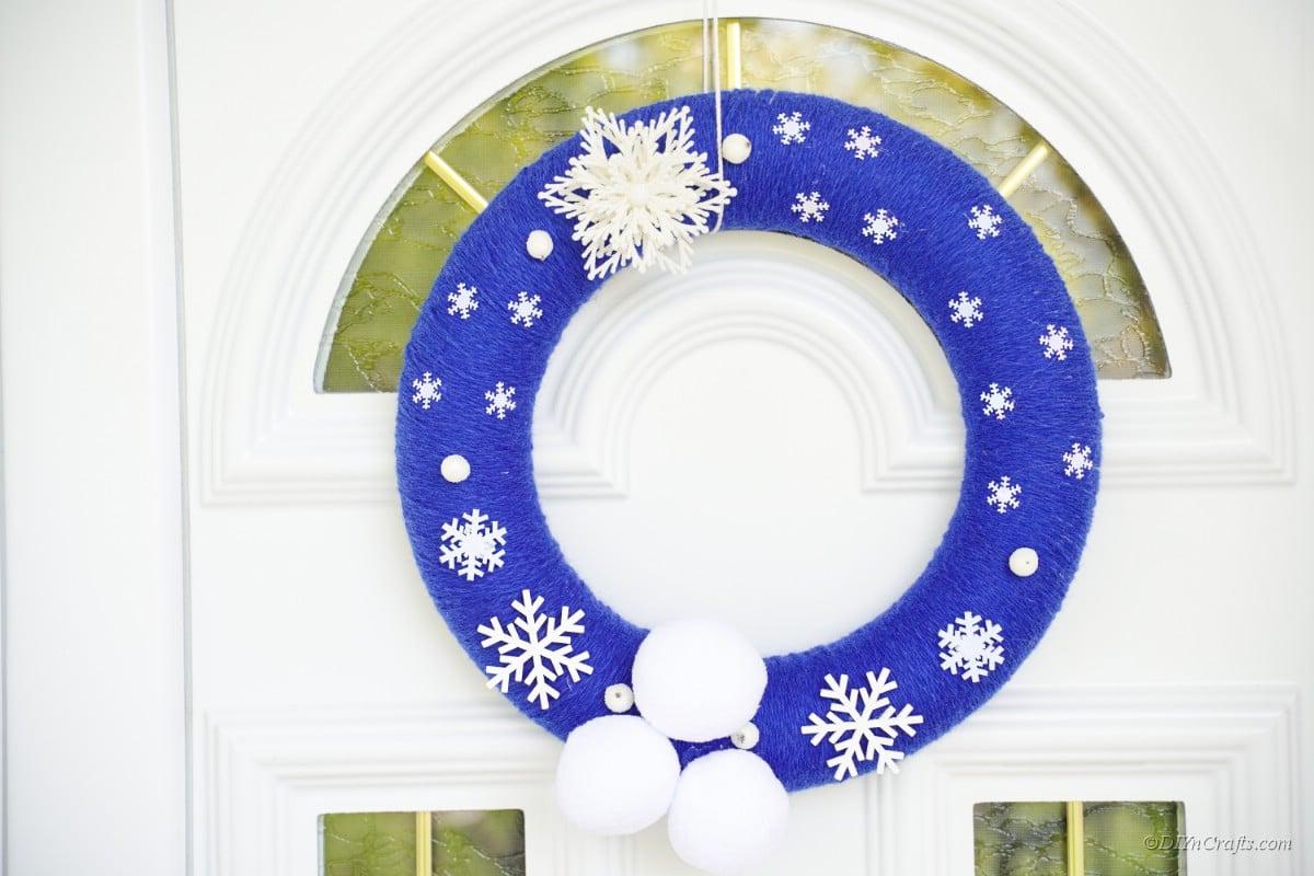 blue winter wreath on door