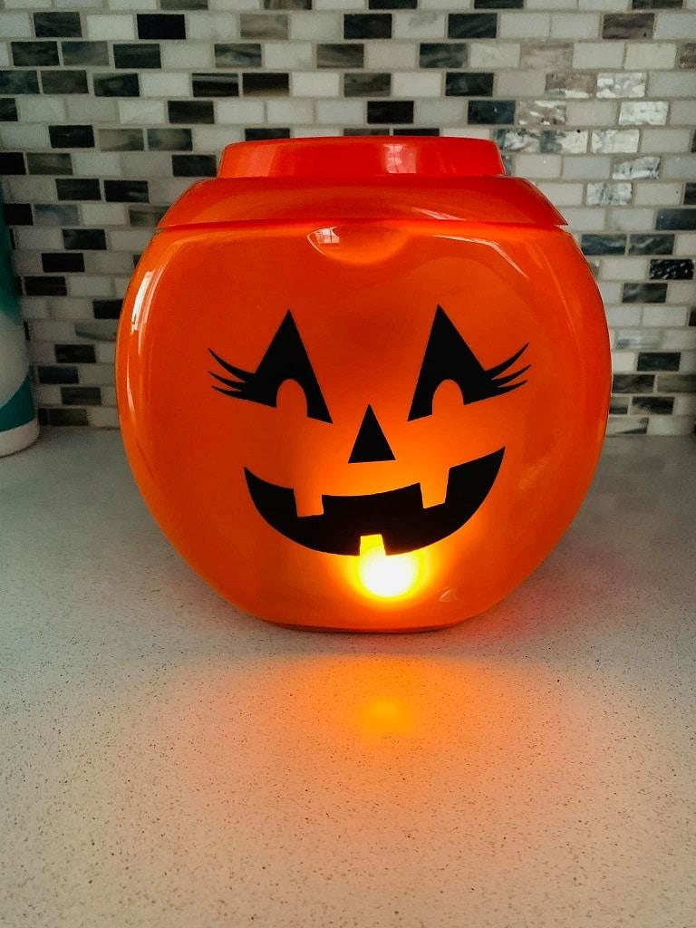 Laundry detergent container pumpkin on kitchen counter