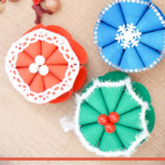 Set of 3 snowflake crafts on a table