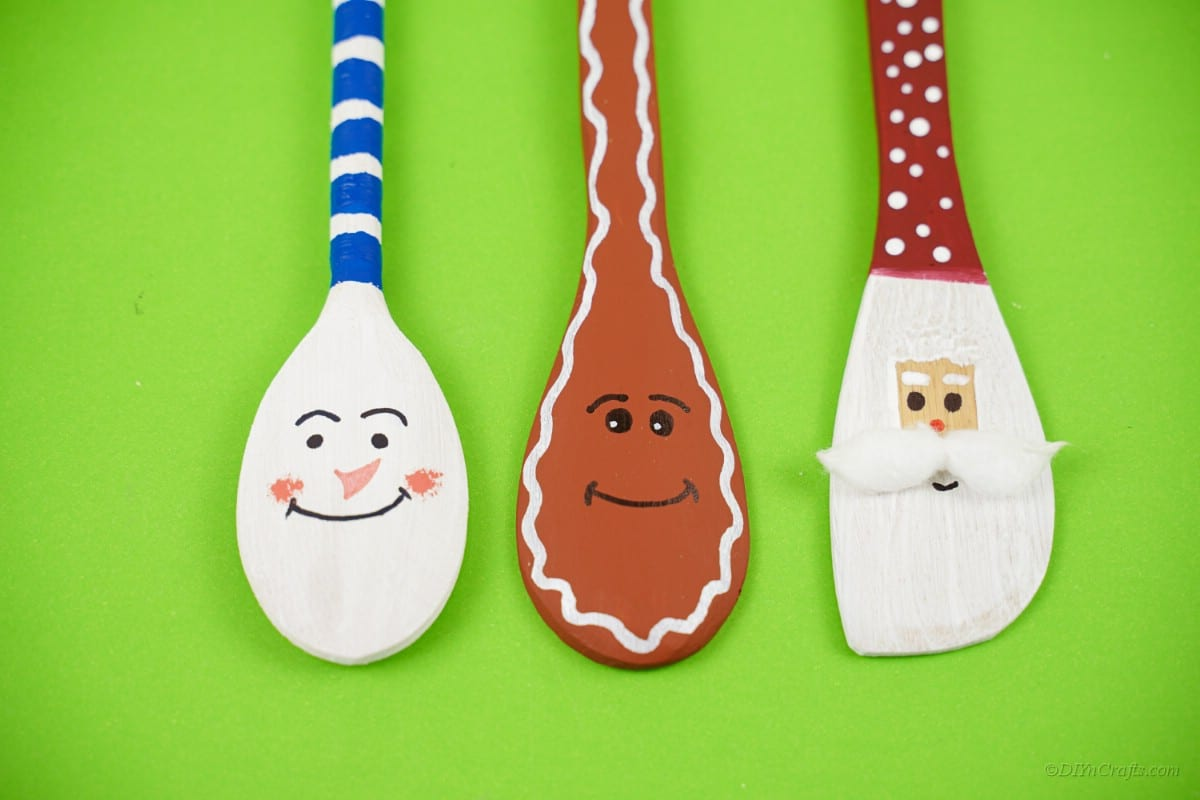 Three wooden spoons with faces Christmas character designs