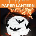 Halloween lantern on table with candles