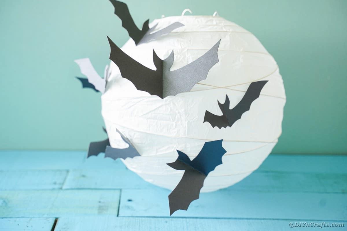 Paper lantern on blue wood