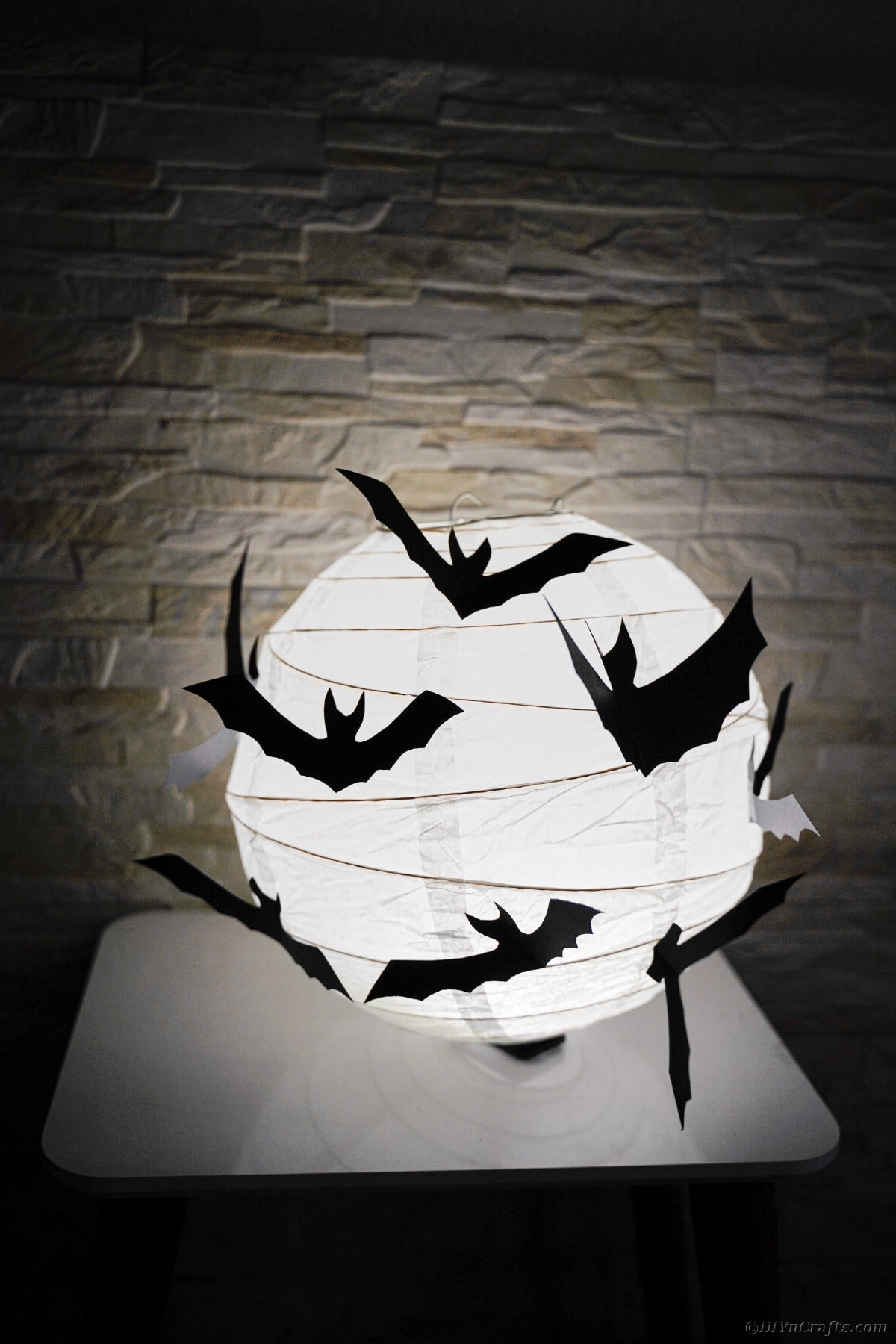 Paper bat lantern on table