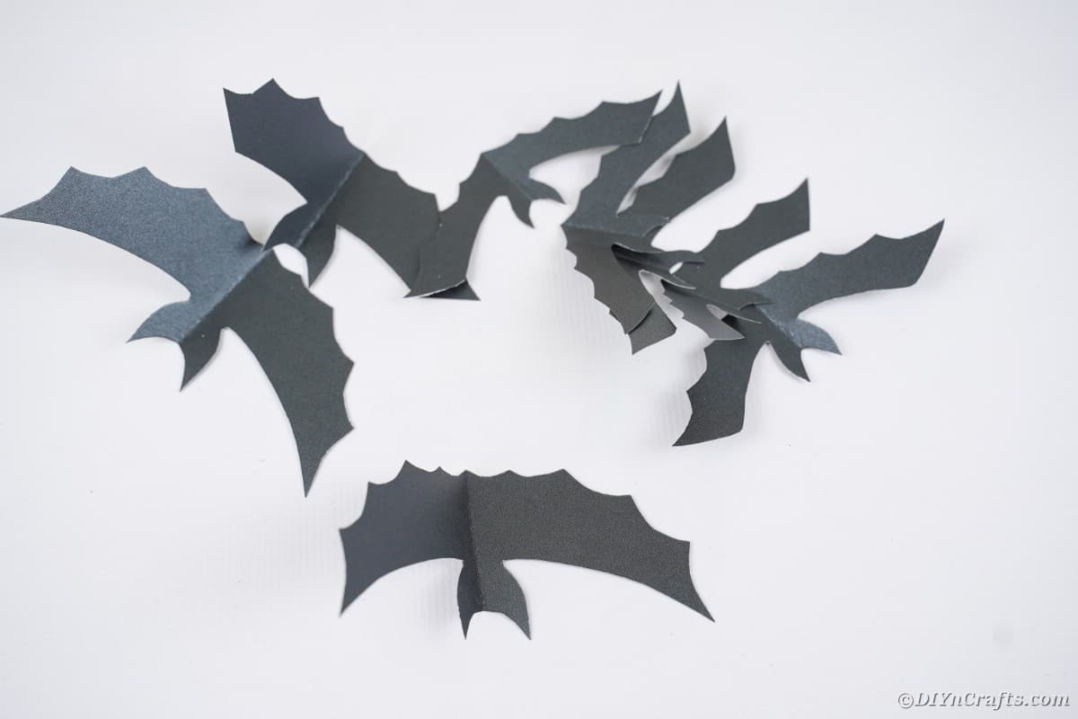 Paper bats on table
