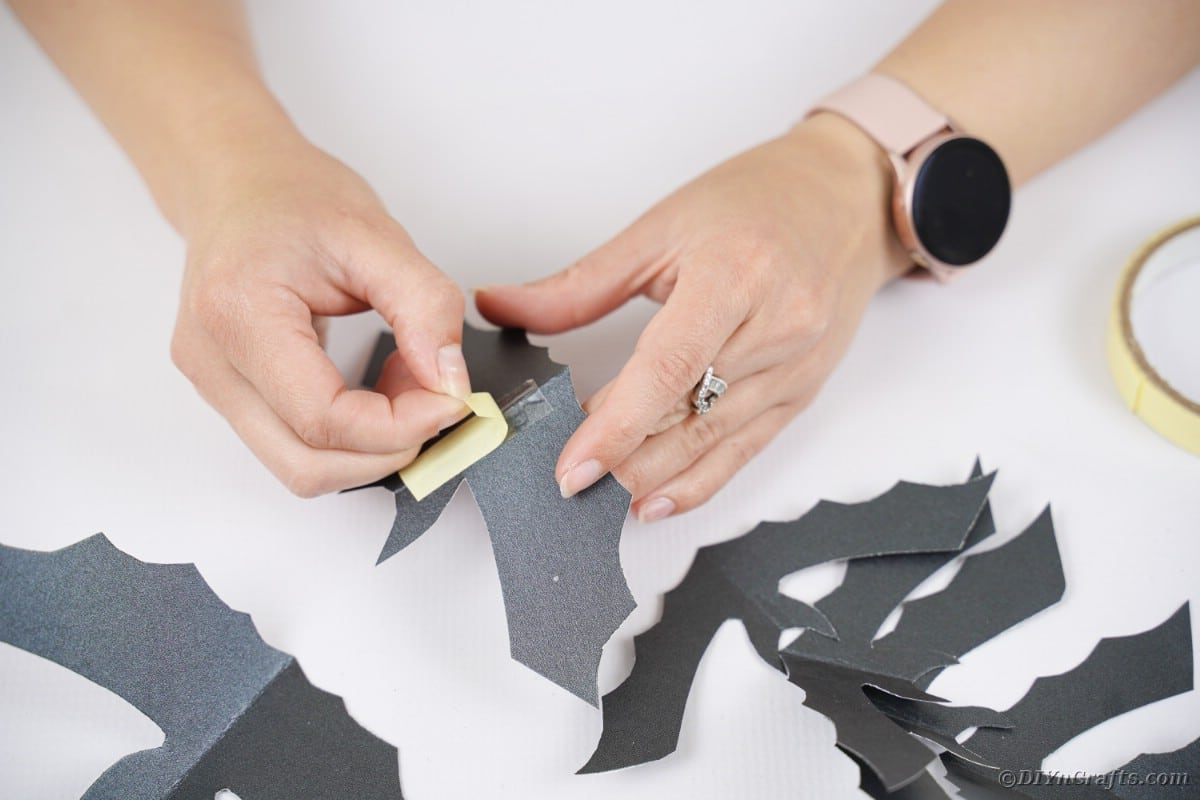 Putting tape on bat