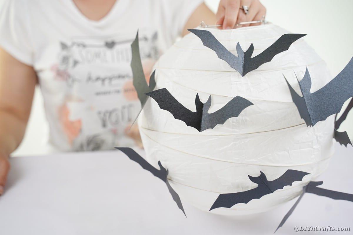 Adding paper bats to lantern