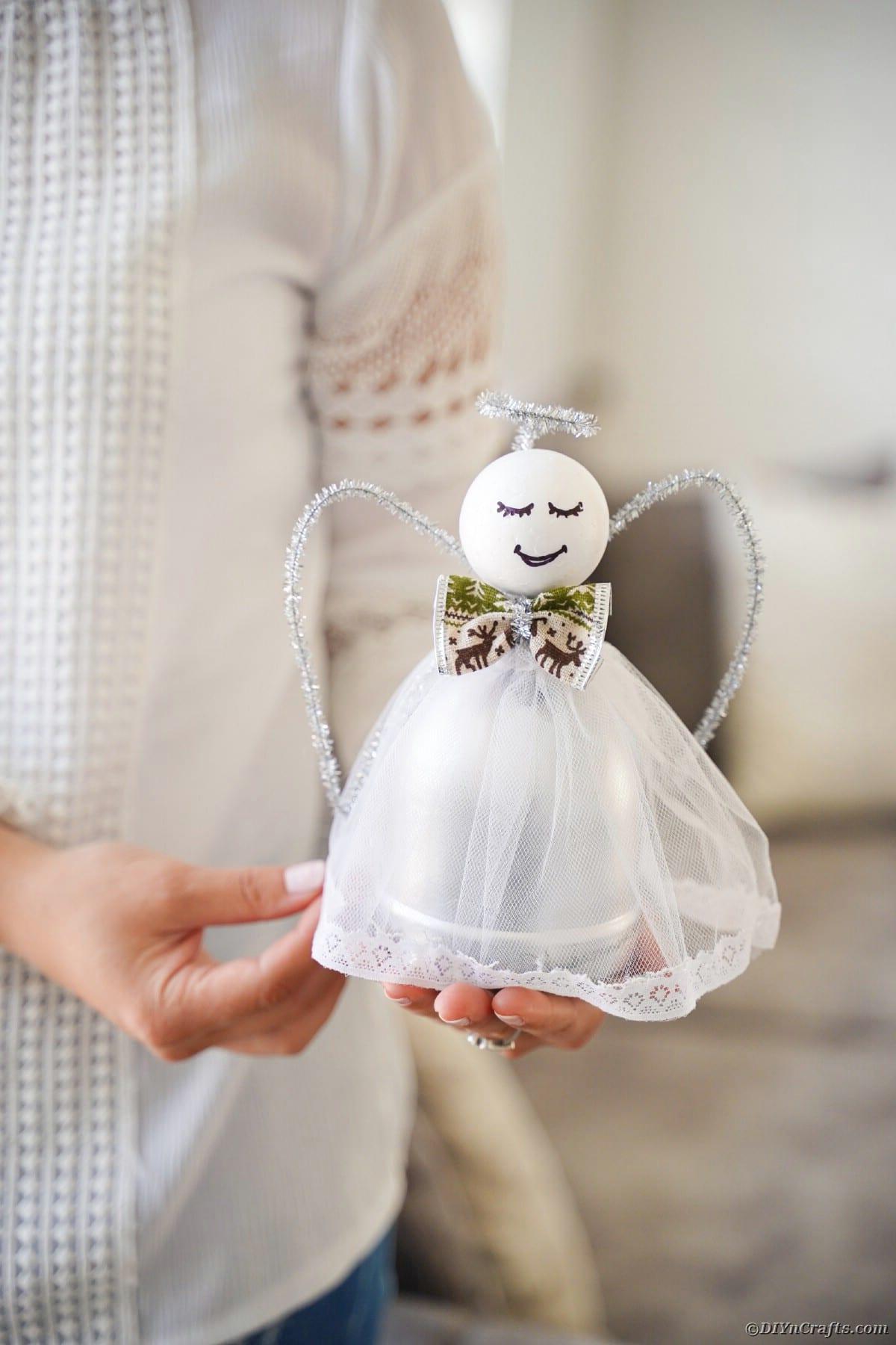 Woman holding bottle angel