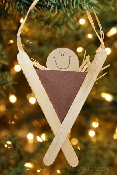 Manger ornament in tree