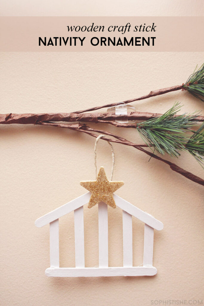 Nativity hanging on branch
