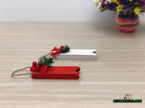 craft stick sleighs on table