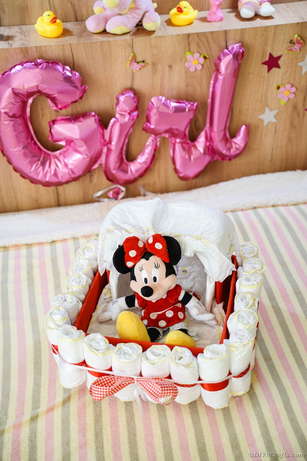 Bassinet diaper cake on bed