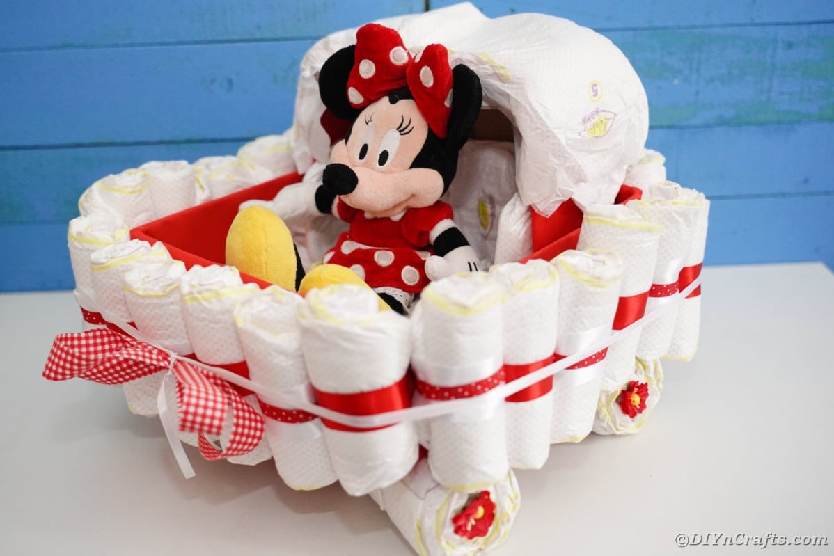 Bassinet diaper cake by blue wall