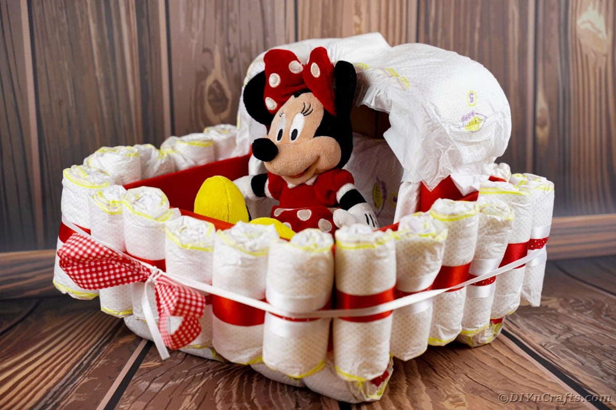 Diaper cake on wood background