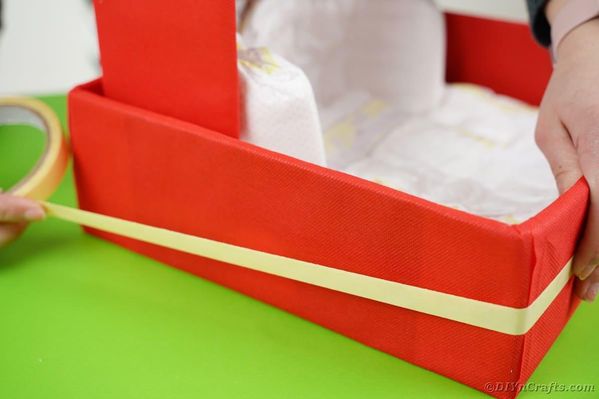 Adding tape to box