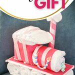 Diaper cake train on blue chair