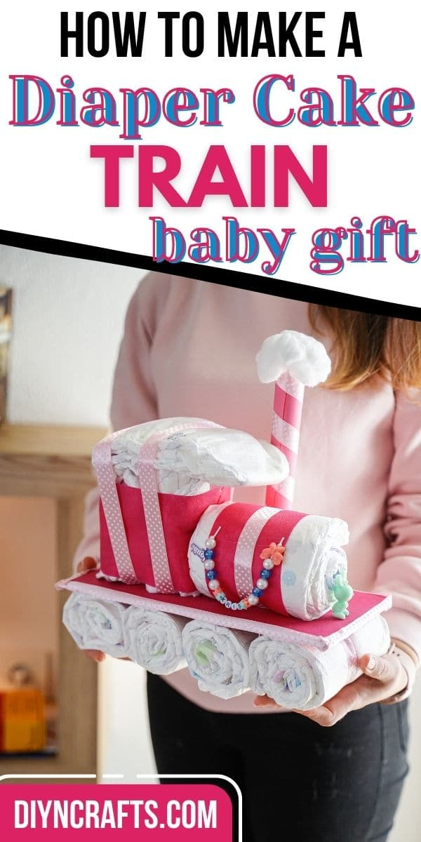 Woman holding diaper cake