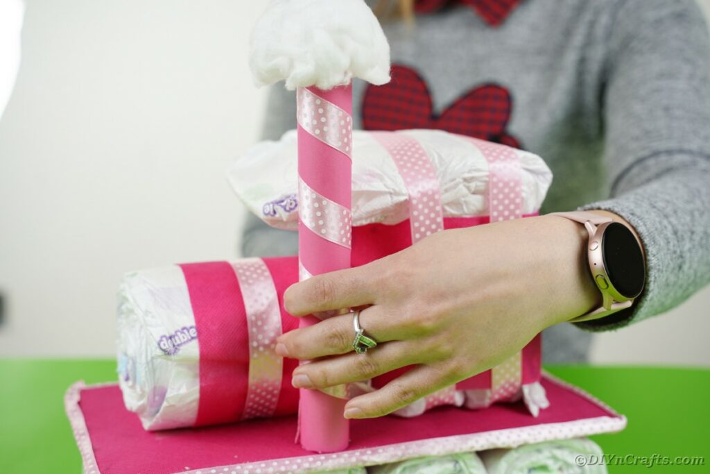 Adding smokestack to diaper cake