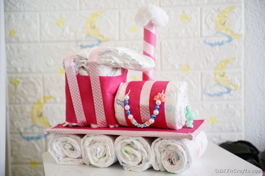 Diaper cake by brick wall