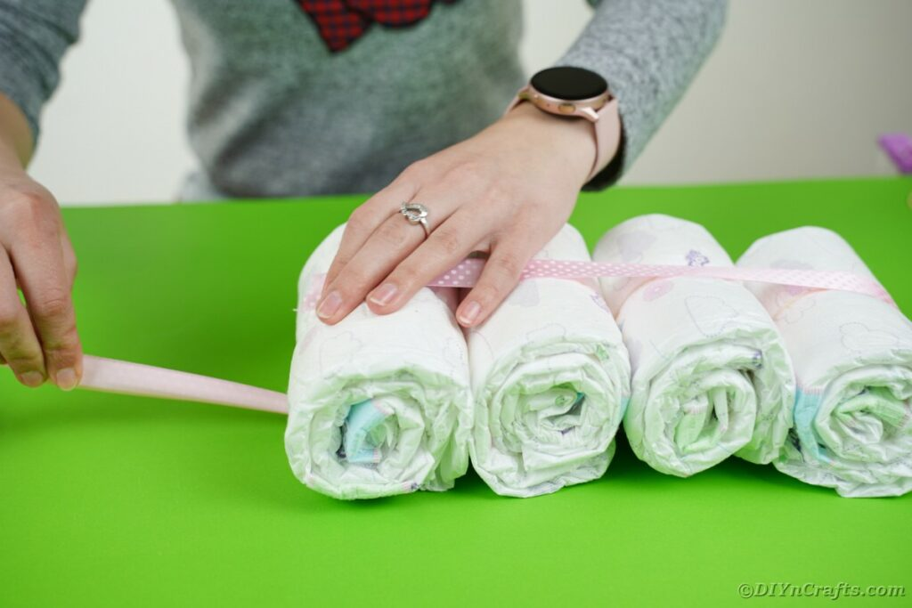Wrapping diaper bundles with ribbon