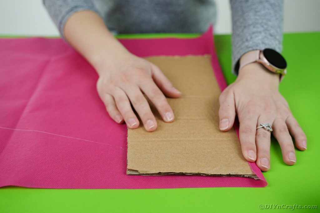 Gluing tissue paper to cardboard