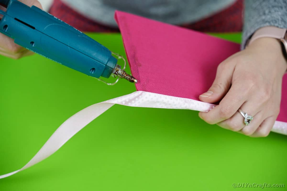 Gluing ribbon on cardboard