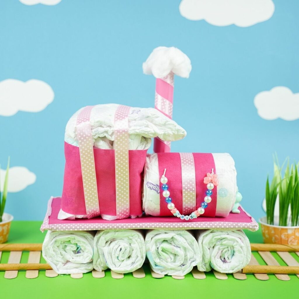 Diaper cake by blue background with clouds