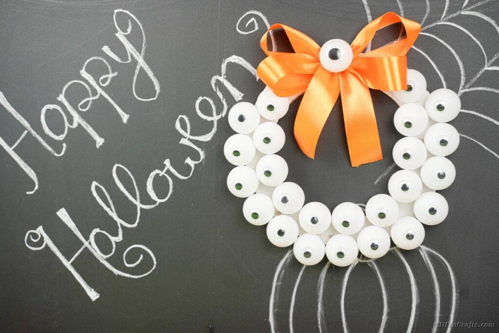 Spooky eyeball wreath on chalkboard