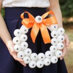 Woman holding eyeball Halloween wreath