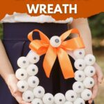 Woman holding eyeball Halloween wreath