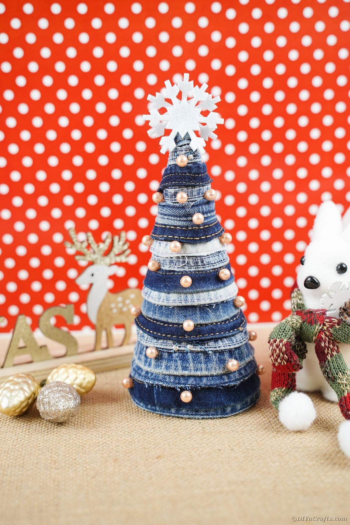 Denim tree by polka dot background