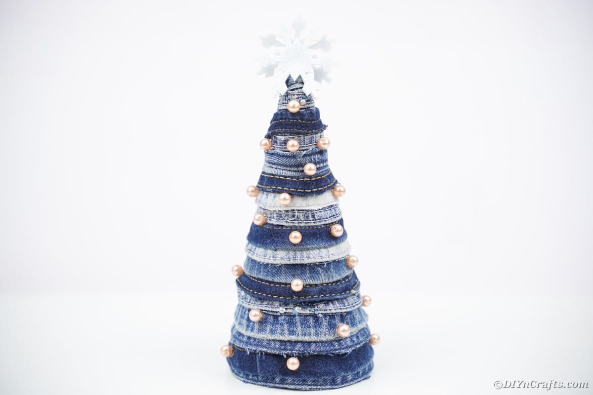 Old blue jean Christmas tree on white background