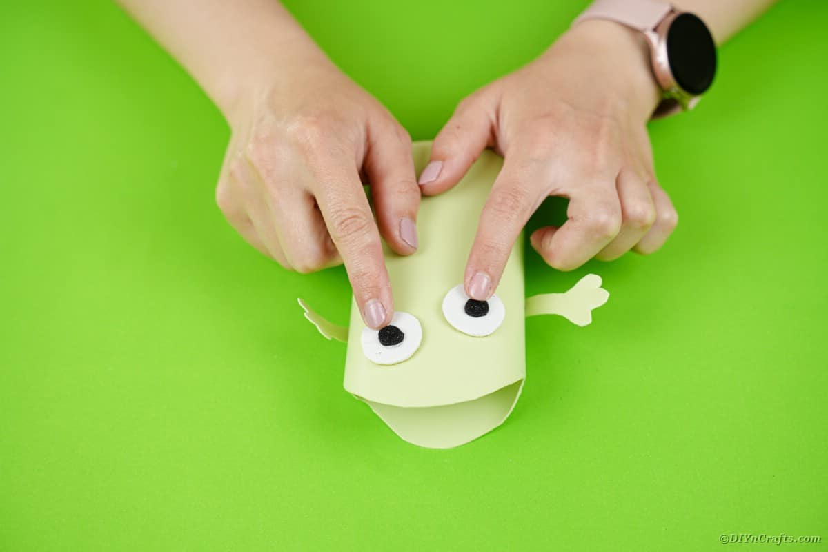Gluing eyes on green monster