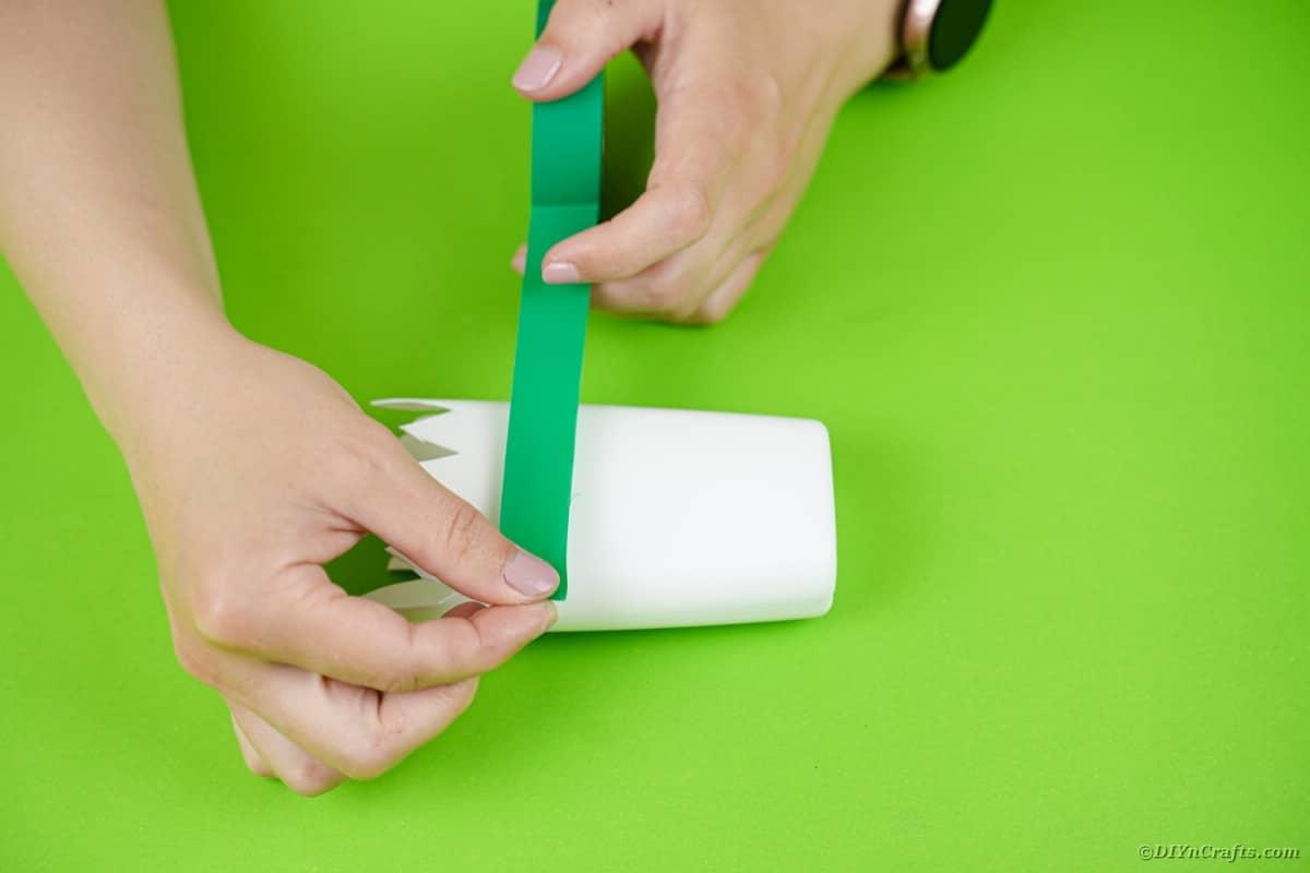 Adding washi tape to bottle