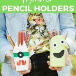 Woman holding monster pencil cans