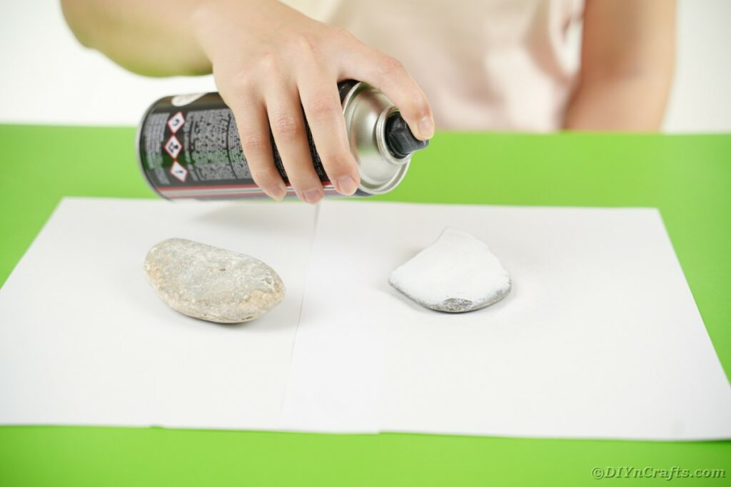 Spray painting a rock