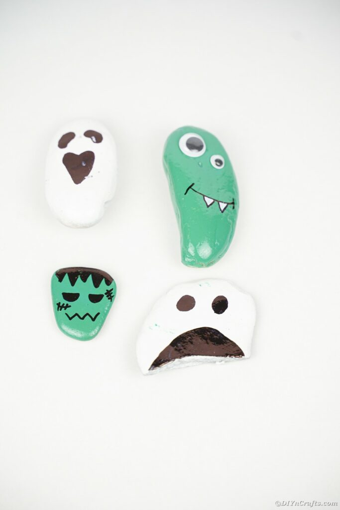 Painted rocks on white surface