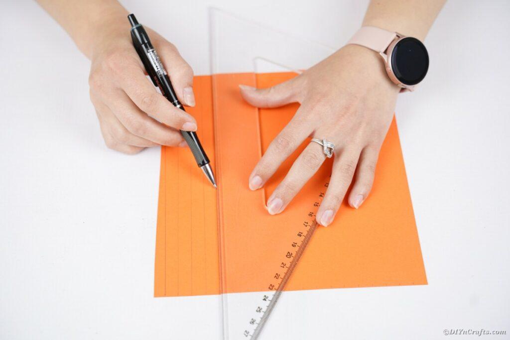 Drawing on orange paper