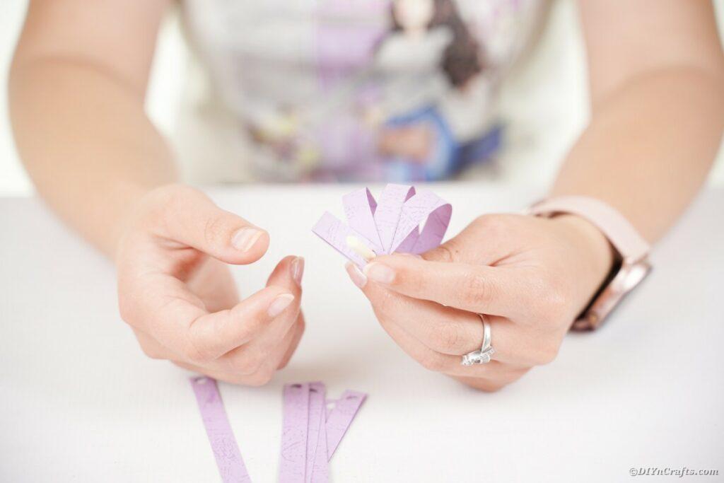 Gluing paper onto dowel