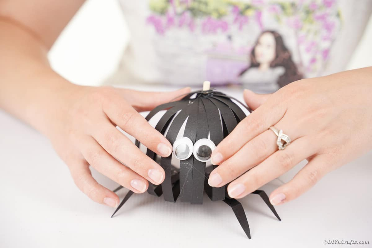 Woman adding eyes to spider