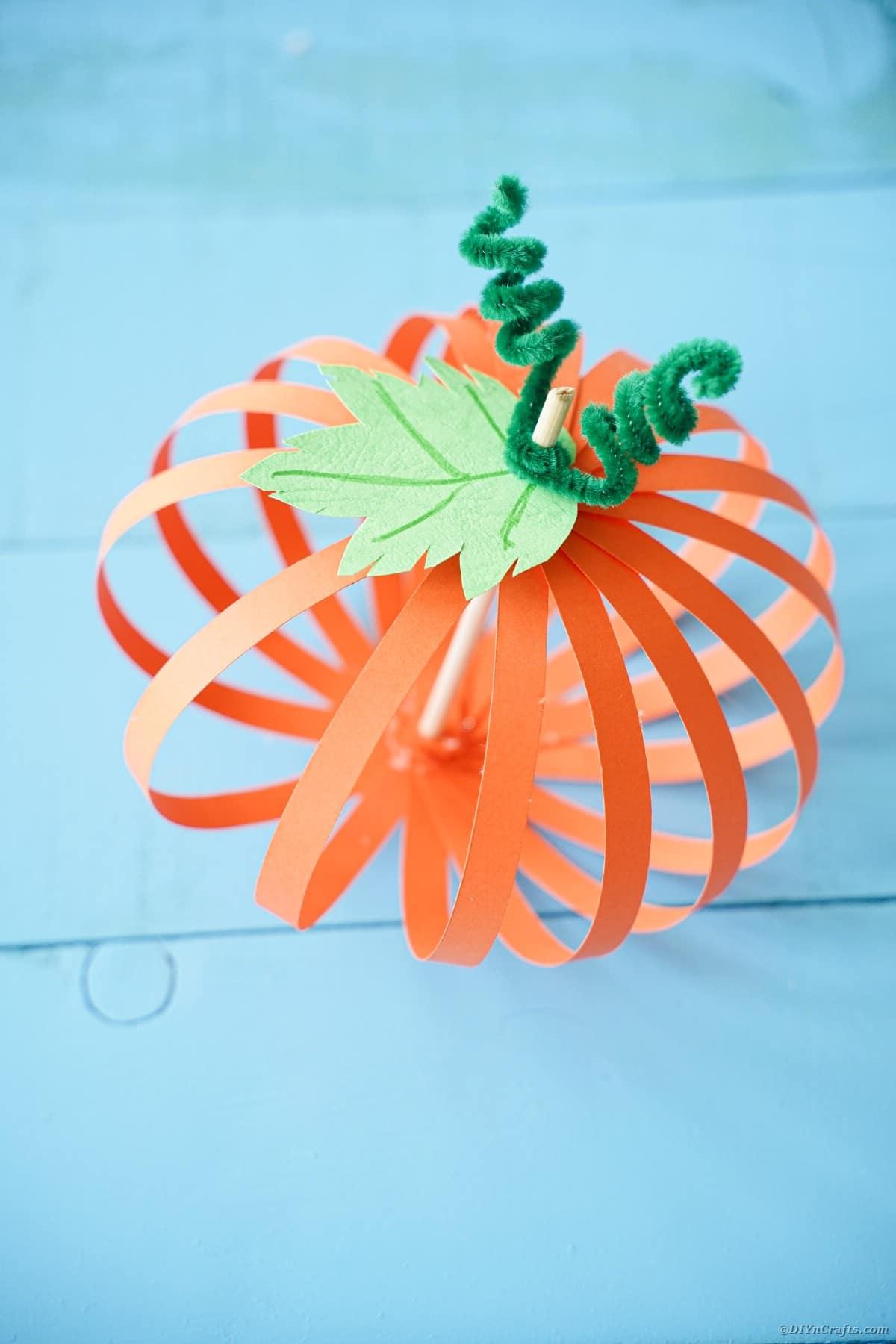 Paper pumpkin on blue boards