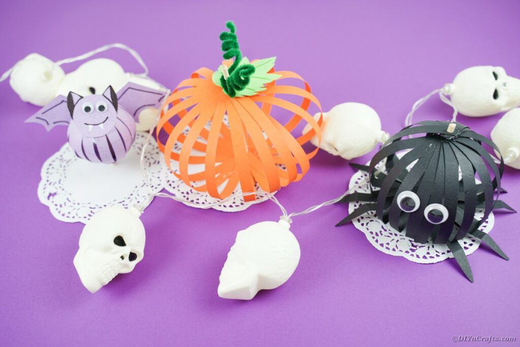 Paper Halloween decorations on purple table