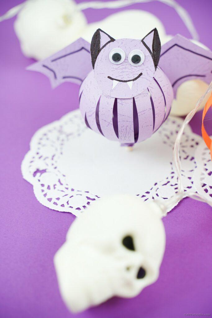 Purple bat on white doily