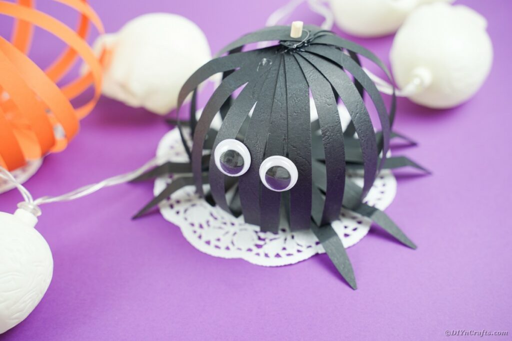 Black spider on white doily