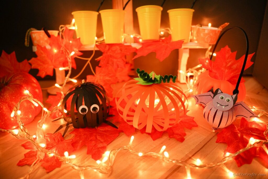 Paper Halloween decorations on table