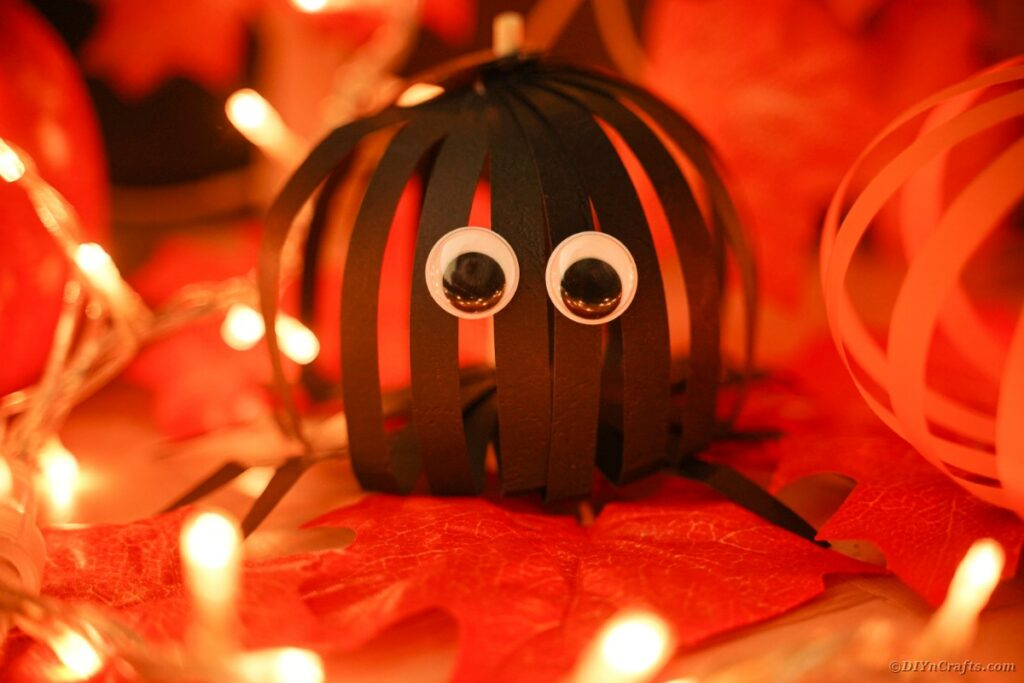Black paper spider on Halloween table