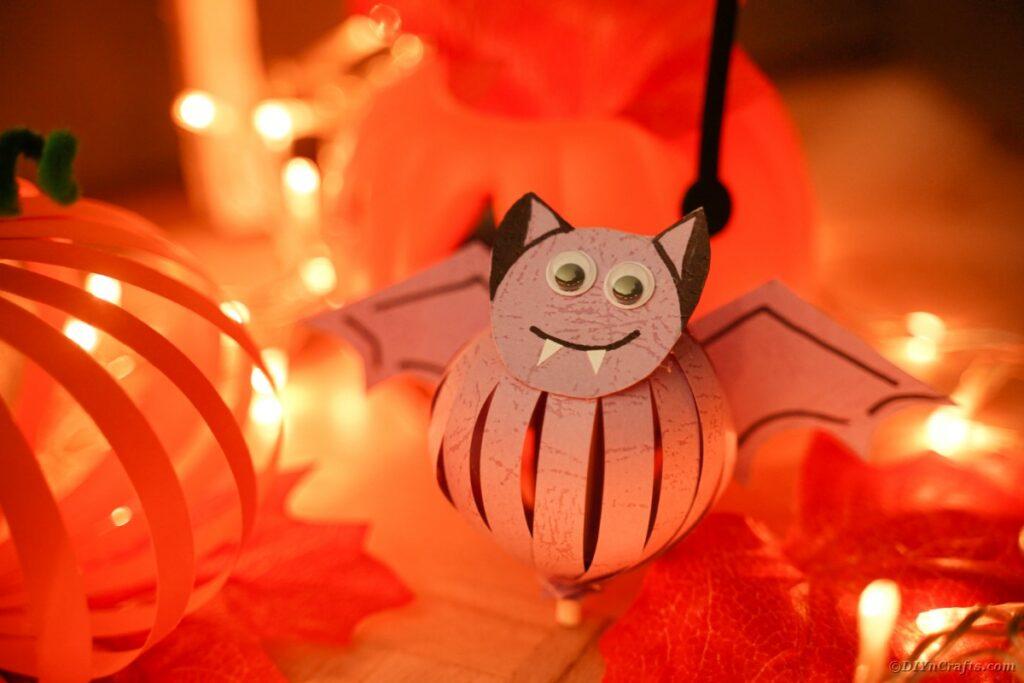 Purple paper bat on Halloween table